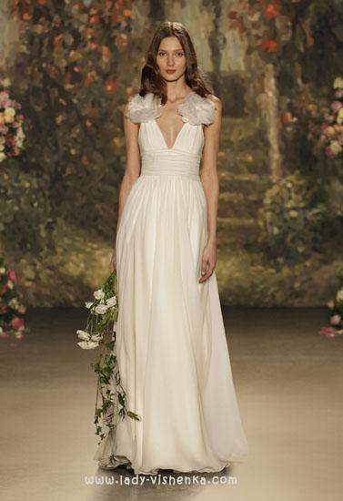 Весільні сукні з бантом