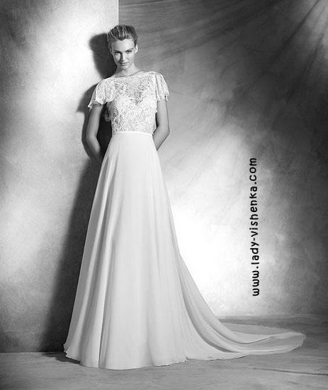 Весільну сукню з закритими плечима Pronovias